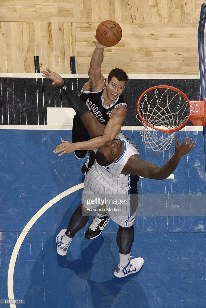 Kris Humphries #43 of the Brooklyn Nets goes in for a baby hook shot against the Orlando Magic during the game on November 30, 2012 at Amway Center in Orlando, Florida.