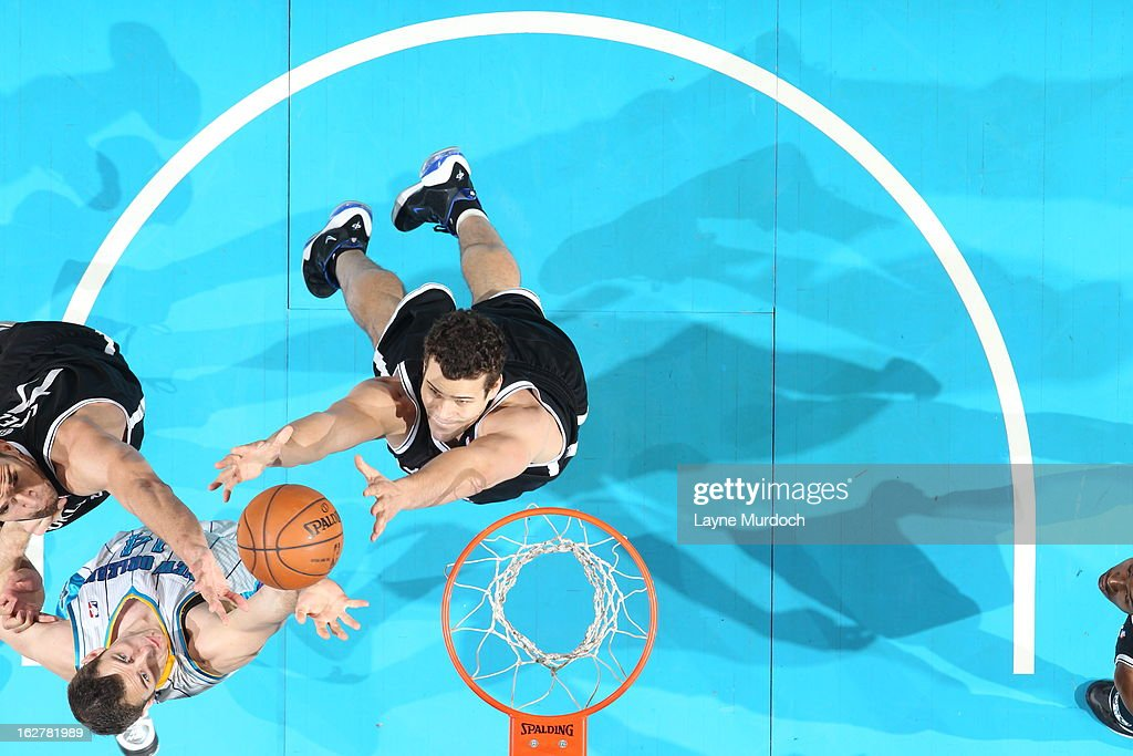 <a gi-track='captionPersonalityLinkClicked' href=/galleries/search?phrase=Kris+Humphries&family=editorial&specificpeople=209199 ng-click='$event.stopPropagation()'>Kris Humphries</a> #43 of the Brooklyn Nets goes up for a rebound against Jason Smith #14 of the New Orleans Hornets on February 26, 2013 at the New Orleans Arena in New Orleans, Louisiana.