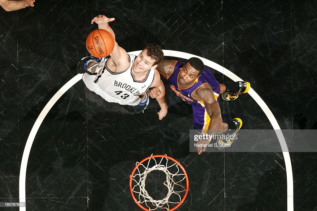 Kris Humphries #43 of the Brooklyn Nets grabs a rebound against Earl Clark #6 of the Los Angeles Lakers on February 5, 2013 at the Barclays Center in the Brooklyn borough of New York City.