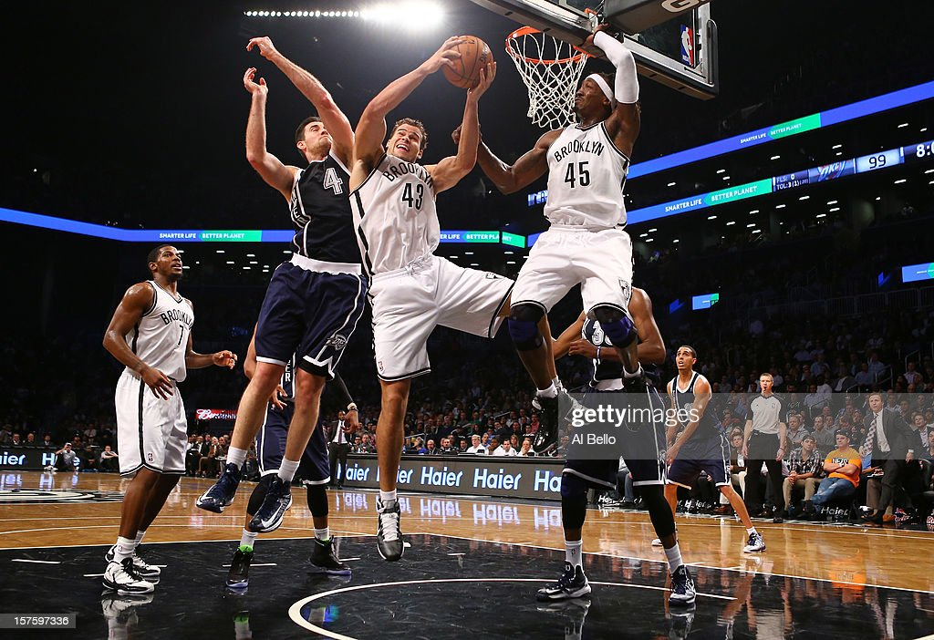 Kris Humphries #43 of the Brooklyn Nets grabs a rebound against Nick Collison #4 of the Oklahoma City Thunder during their game at the Barclays Center on December 4, 2012 in the Brooklyn borough of New York City.