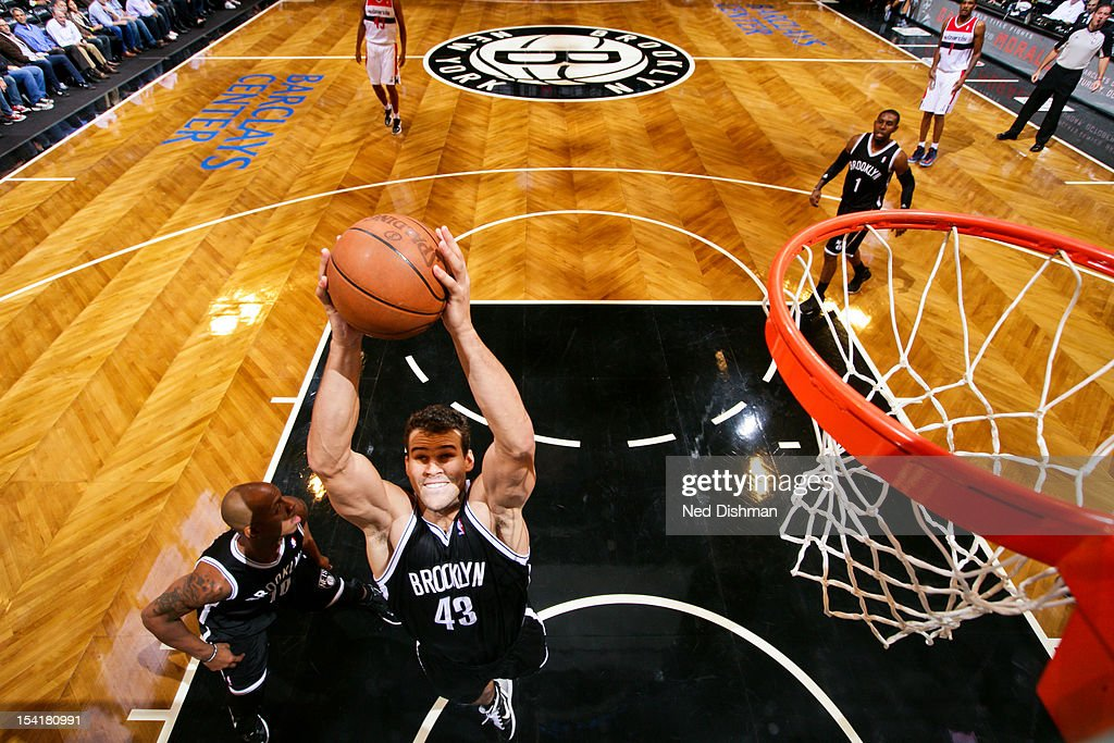 <a gi-track='captionPersonalityLinkClicked' href=/galleries/search?phrase=Kris+Humphries&family=editorial&specificpeople=209199 ng-click='$event.stopPropagation()'>Kris Humphries</a> #43 of the Brooklyn Nets grabs a rebound against the Washington Wizards at the Barclays Center on October 15, 2012 in the Brooklyn borough of New York City.