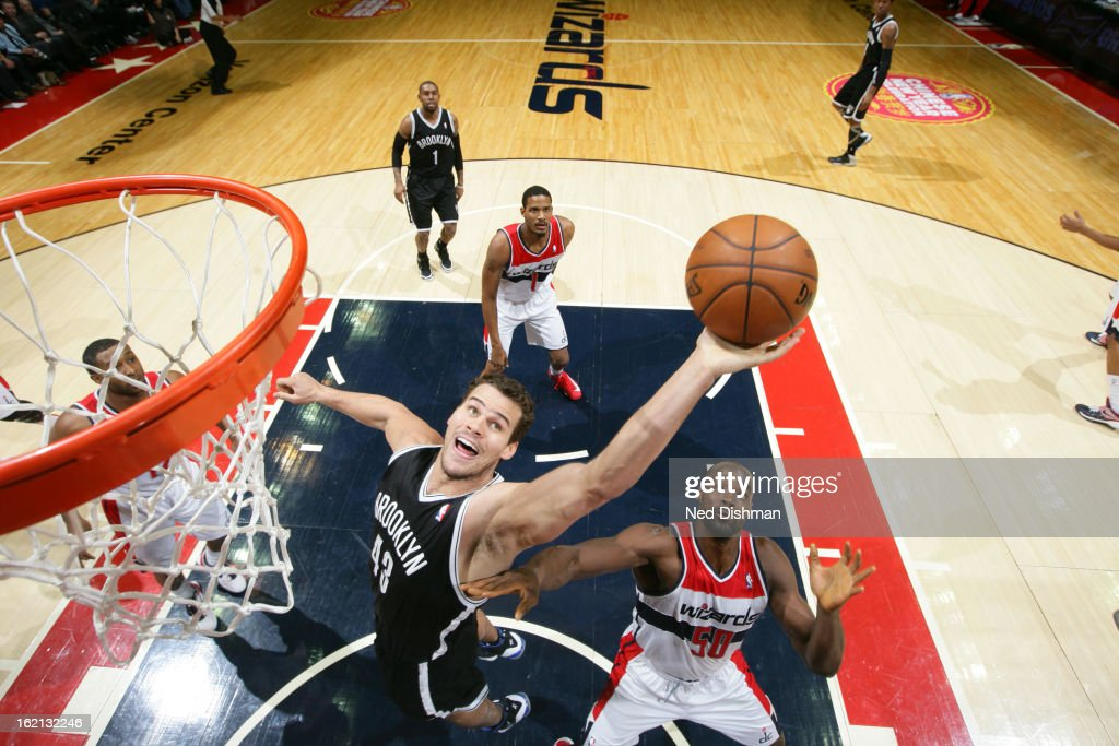 <a gi-track='captionPersonalityLinkClicked' href=/galleries/search?phrase=Kris+Humphries&family=editorial&specificpeople=209199 ng-click='$event.stopPropagation()'>Kris Humphries</a> #43 of the Brooklyn Nets grabs the rebound against <a gi-track='captionPersonalityLinkClicked' href=/galleries/search?phrase=Emeka+Okafor&family=editorial&specificpeople=201739 ng-click='$event.stopPropagation()'>Emeka Okafor</a> #50 of the Washington Wizards on February 8, 2013 at the Verizon Center in Washington, DC.