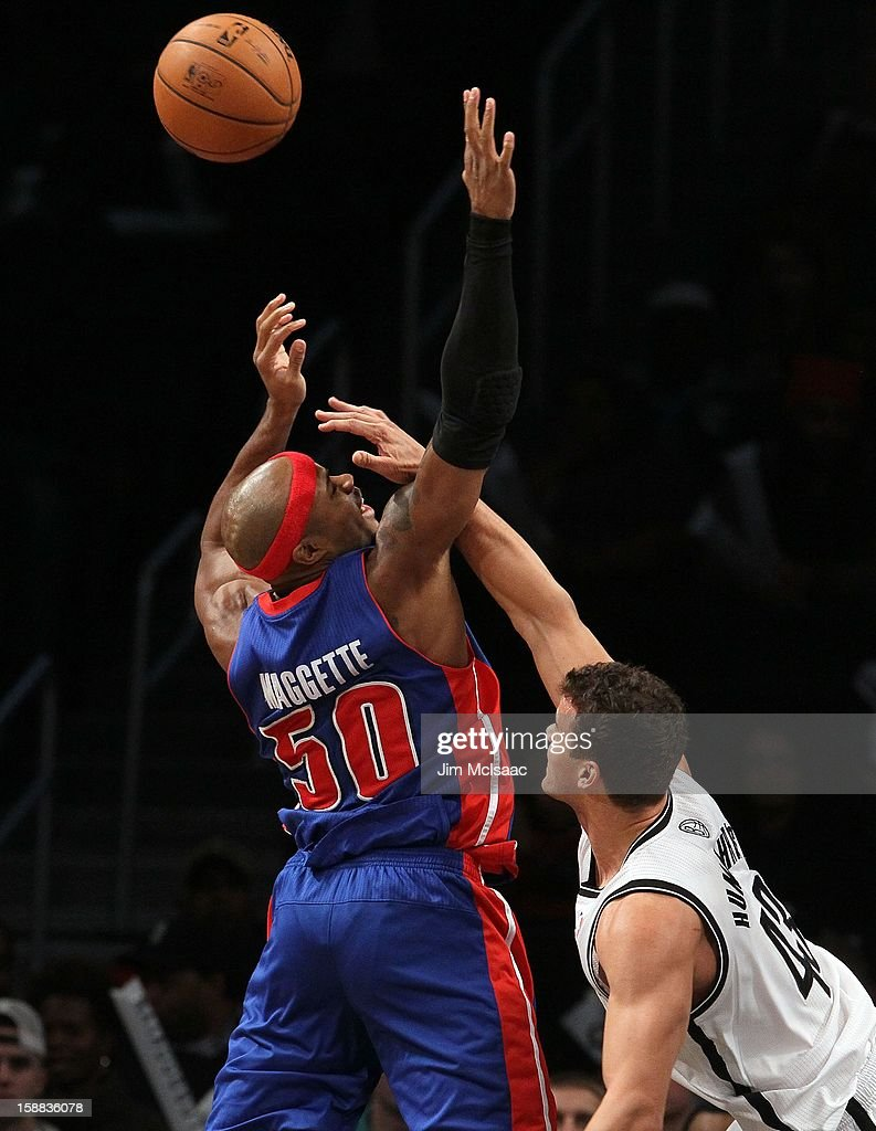 Kris Humphries #43 of the Brooklyn Nets in action against Corey Maggette #50 of the Detroit Pistons at Barclays Center on December 14, 2012 in the Brooklyn borough of New York City.The Nets defeated the Pistons 107-105 in double overtime.