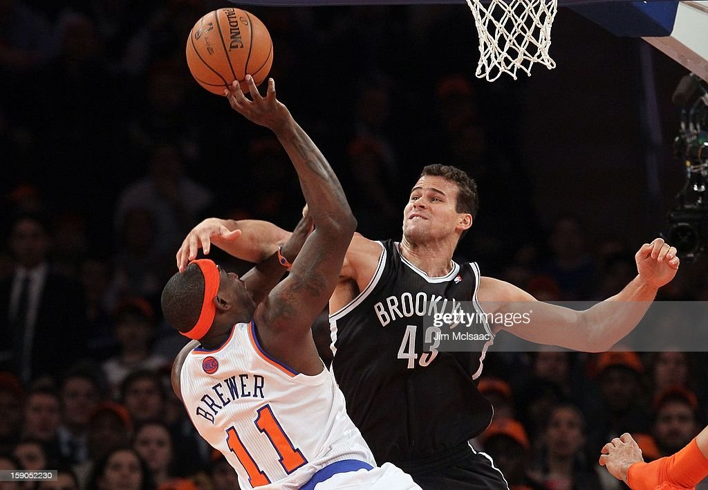 Kris Humphries #43 of the Brooklyn Nets in action against Ronnie Brewer #11 of the New York Knicks at Madison Square Garden on December 19, 2012 in New York City. The Knicks defeated the Nets 100-86.