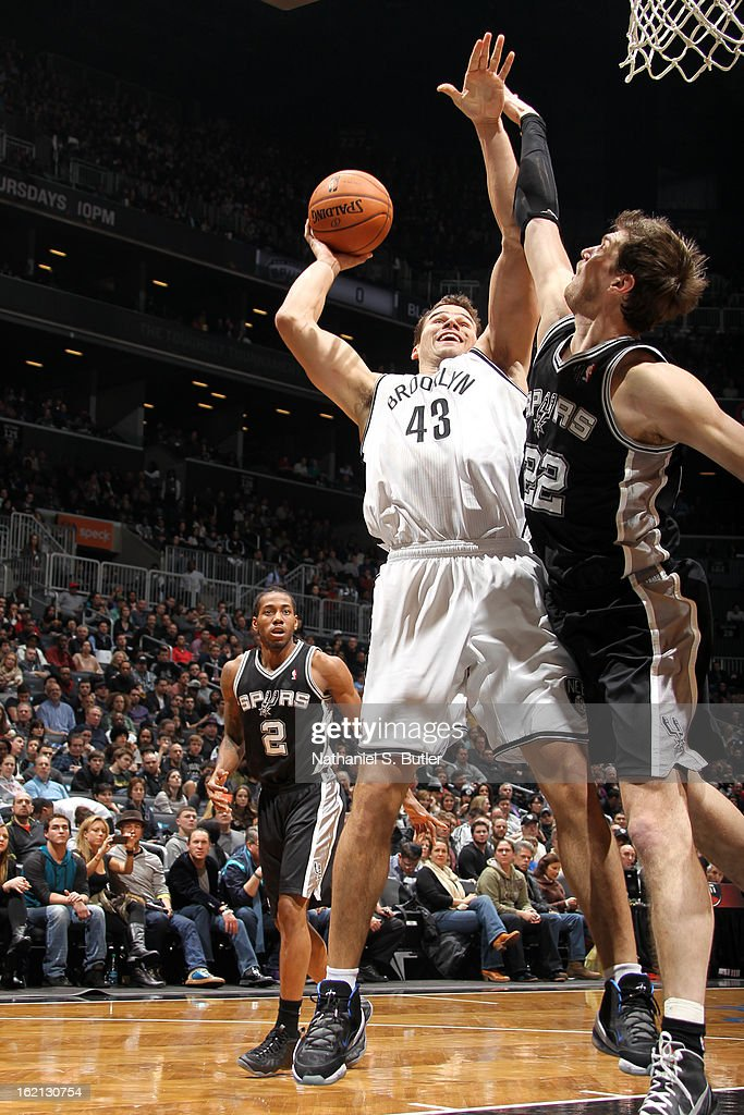 Kris Humphries #43 of the Brooklyn Nets puts up a shot against the San Antonio Spurs on February 10, 2013 at the Barclays Center in the Brooklyn borough of New York City.