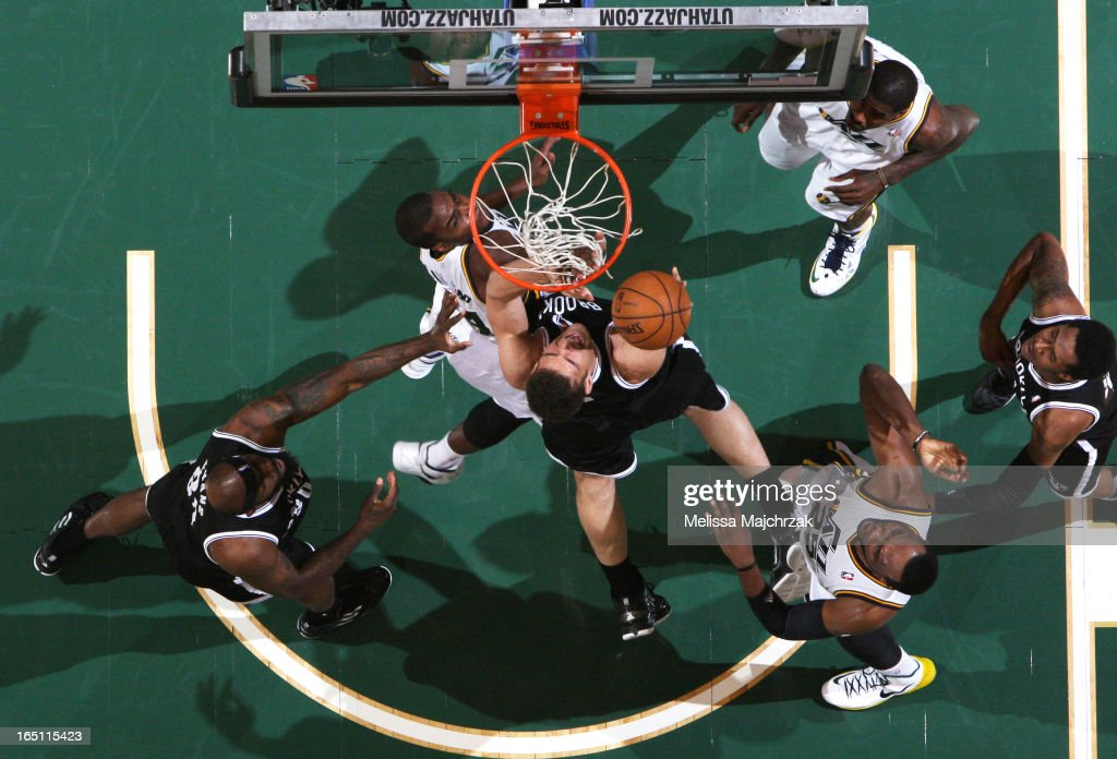 Kris Humphries of the Brooklyn Nets rebounds against the Utah Jazz at Energy Solutions Arena on March 30 2013 in Salt Lake City Utah NOTE TO USER...