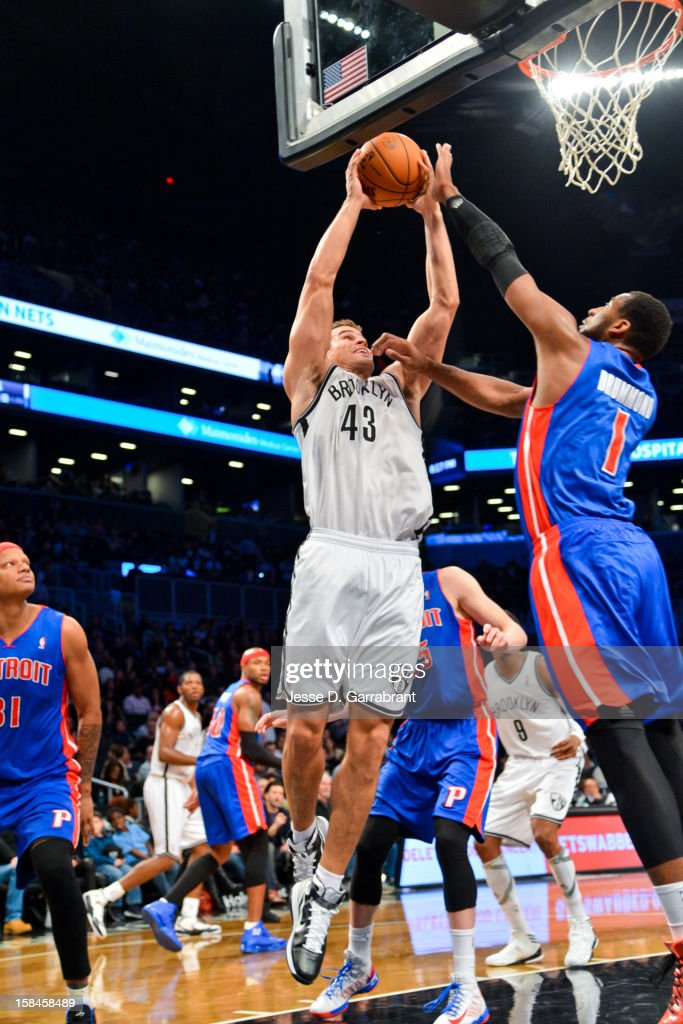 Kris Humphries #43 of the Brooklyn Nets rises for a dunk against Andre Drummond #1 of the Detroit Pistons at the Barclays Center on December 14, 2012 in the Brooklyn borough of New York City.