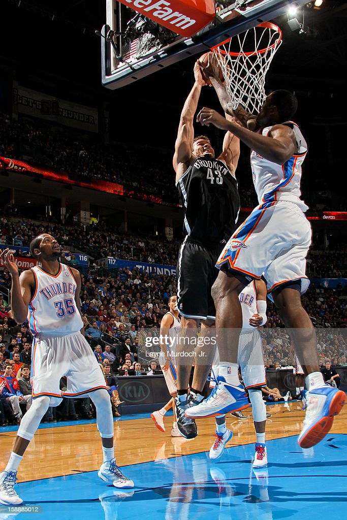 Kris Humphries #43 of the Brooklyn Nets rises for a dunk against the Oklahoma City Thunder on January 2, 2013 at the Chesapeake Energy Arena in Oklahoma City, Oklahoma.