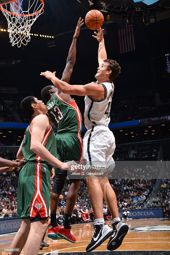 Kris Humphries #43 of the Brooklyn Nets shoots against Ekpe Udoh #13 of the Milwaukee Bucks during the game at the Barclays Center on December 9, 2012 in Brooklyn, New York.