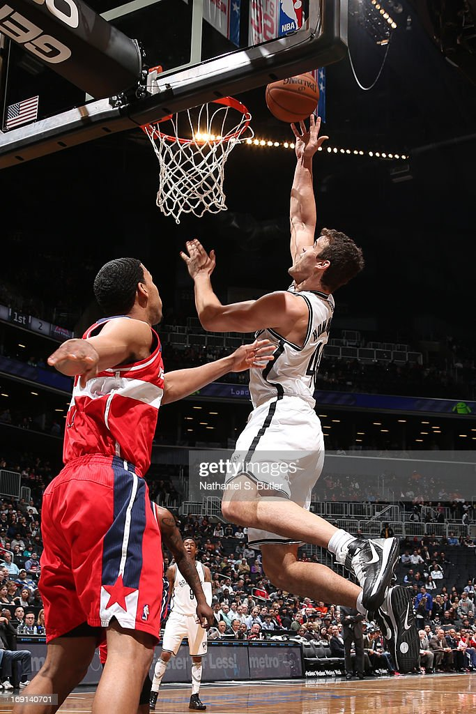 Kris Humphries #43 of the Brooklyn Nets shoots against Garrett Temple #17 of the Washington Wizards on April 15, 2013 at the Barclays Center in the Brooklyn borough of New York City.