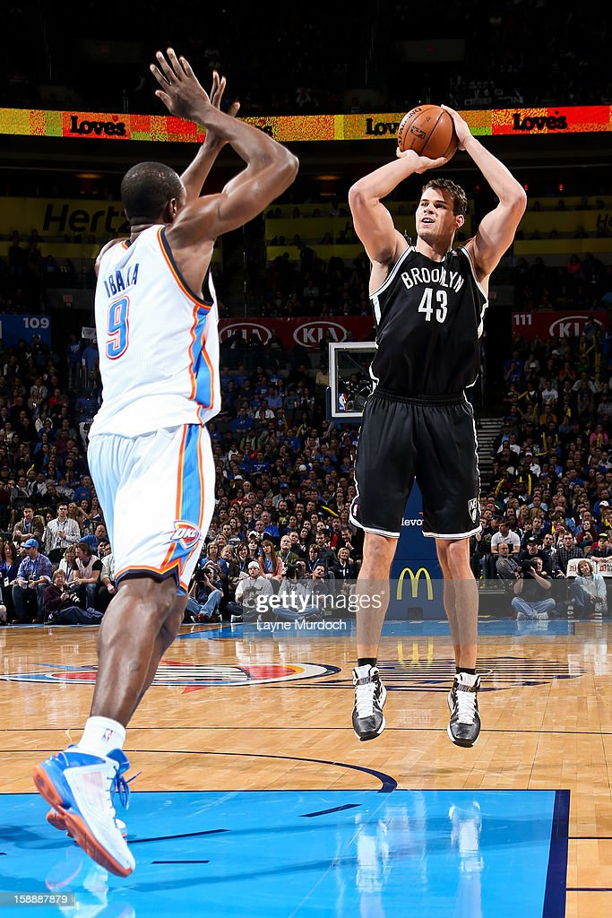 Kris Humphries #43 of the Brooklyn Nets shoots against Serge Ibaka #9 of the Oklahoma City Thunder on January 2, 2013 at the Chesapeake Energy Arena in Oklahoma City, Oklahoma.
