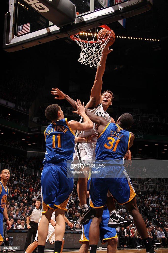 Kris Humphries #43 of the Brooklyn Nets shoots over Klay Thompson #11 and Festus Ezeli #31 of the Golden State Warriors on December 7, 2012 at the Barclays Center in the Brooklyn Borough of New York City.