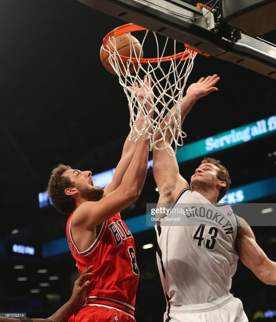 <a gi-track='captionPersonalityLinkClicked' href=/galleries/search?phrase=Kris+Humphries&family=editorial&specificpeople=209199 ng-click='$event.stopPropagation()'>Kris Humphries</a> #43 of the Brooklyn Nets stops <a gi-track='captionPersonalityLinkClicked' href=/galleries/search?phrase=Marco+Belinelli&family=editorial&specificpeople=847592 ng-click='$event.stopPropagation()'>Marco Belinelli</a> #8 of the Chicago Bulls during Game Two of the Eastern Conference Quarterfinals of the 2013 NBA Playoffs at the Barclays Center on April 22, 2013 in New York City.