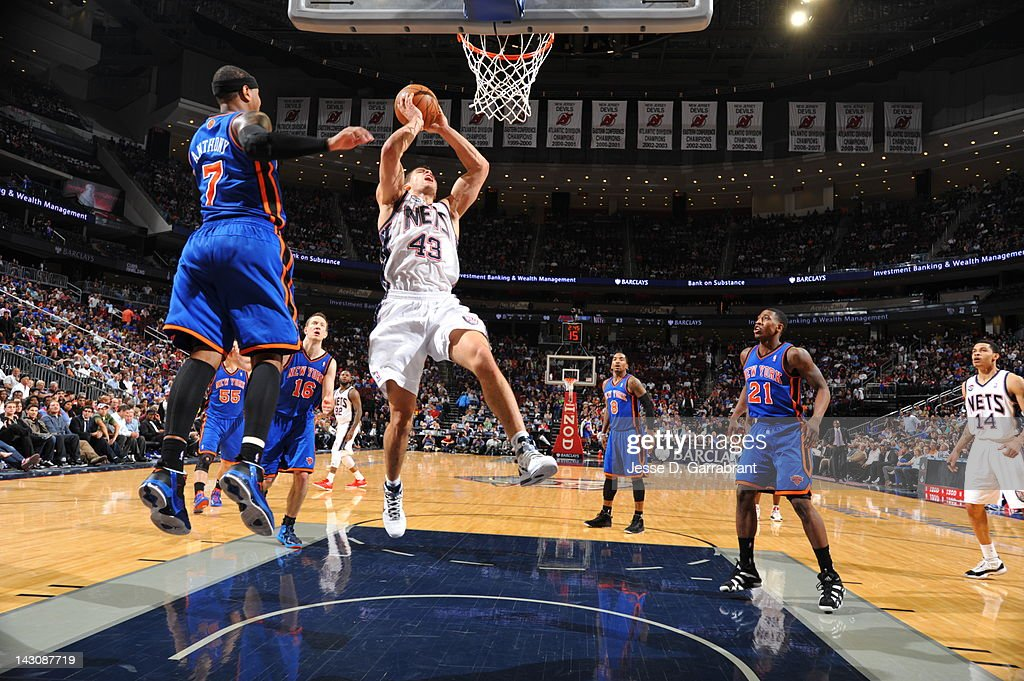 <a gi-track='captionPersonalityLinkClicked' href=/galleries/search?phrase=Kris+Humphries&family=editorial&specificpeople=209199 ng-click='$event.stopPropagation()'>Kris Humphries</a> #43 of the New Jersey Nets goes to the basket against <a gi-track='captionPersonalityLinkClicked' href=/galleries/search?phrase=Carmelo+Anthony&family=editorial&specificpeople=201494 ng-click='$event.stopPropagation()'>Carmelo Anthony</a> #7 of the New York Knicks on April 18, 2012 at the Prudential Center in Newark, New Jersey.