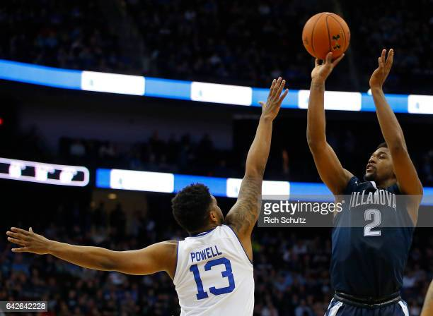 Kris Jenkins of the Villanova Wildcats attempts a shot as Myles Powell of the Seton Hall Pirates defends during the first half of an NCAA college...