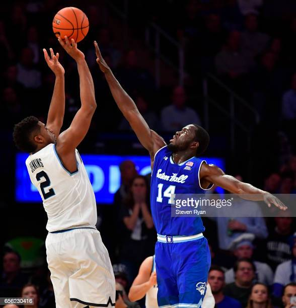 Kris Jenkins of the Villanova Wildcats attempts a shot defended by Ismael Sanogo of the Seton Hall Pirates during the Big East Basketball Tournament...
