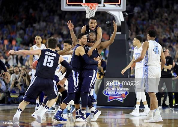 Kris Jenkins of the Villanova Wildcats celebrates with teammates after making the gamewinning three pointer to defeat the North Carolina Tar Heels...