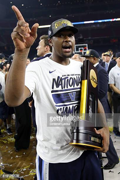 Kris Jenkins of the Villanova Wildcats celebrates with the trophy after defeating the North Carolina Tar Heels 7774 to win the 2016 NCAA Men's Final...