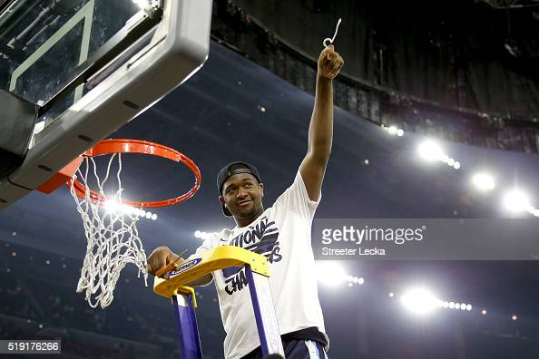Kris Jenkins of the Villanova Wildcats cuts the net after defeating the North Carolina Tar Heels 7774 to win the 2016 NCAA Men's Final Four National...