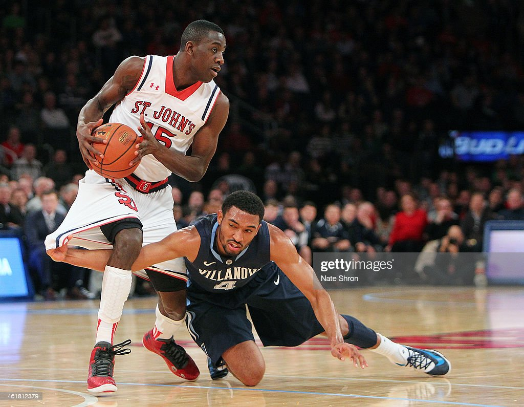 Kris Jenkins of the Villanova Wildcats gets caught as he reaches to guard Ryan Arcidiacono of the St John's Red Storm during the game at Madison...