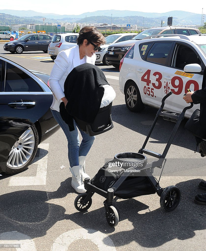 <a gi-track='captionPersonalityLinkClicked' href=/galleries/search?phrase=Kris+Jenner&family=editorial&specificpeople=762610 ng-click='$event.stopPropagation()'>Kris Jenner</a> and baby North West are seen leaving Florence Airport after Kim Kardashian And Kanye West's wedding on May 25, 2014 in Florence, Italy.
