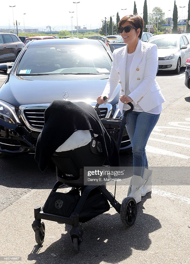 <a gi-track='captionPersonalityLinkClicked' href=/galleries/search?phrase=Kris+Jenner&family=editorial&specificpeople=762610 ng-click='$event.stopPropagation()'>Kris Jenner</a> and baby North West leave Florence Airport after Kim Kardashian And Kanye West's wedding on May 25, 2014 in Florence, Italy.