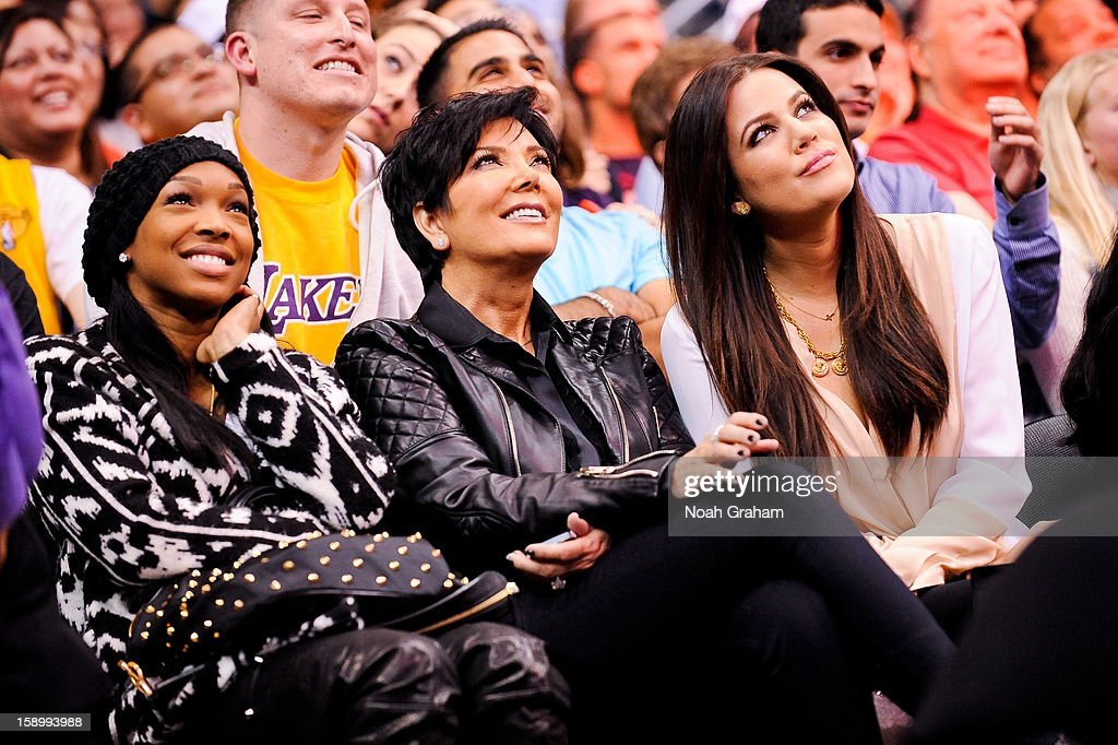 Kris Jenner, center, and Khloe Kardashian Odom, right, attend a game between the Los Angeles Lakers and Los Angeles Clippers at Staples Center on January 4, 2013 in Los Angeles, California.