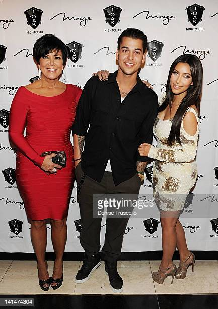 Kris Jenner Rob Kardashian and Kim Kardashian arrive at Rob Kardashian's birthday celebration at 1 Oak on March 16 2012 in Las Vegas Nevada