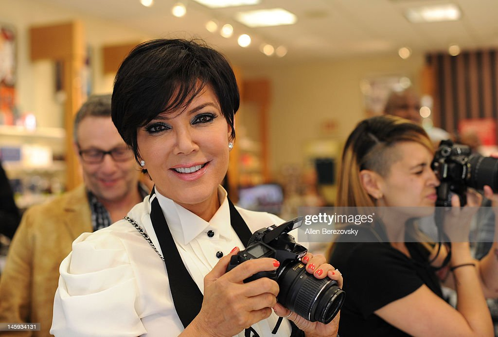 Kris Jenner takes pictures at Lamar Odom and Khloe Kardashian Odom's personal appearance to promote their 'Unbreakable Bond' fragrance at Perfumania on June 7, 2012 in Orange, California.