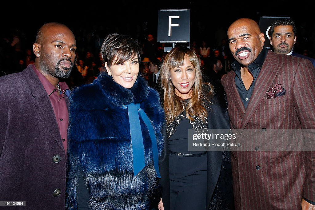 Kris Jenner with her companion Corey Gamble and TV Host Steve Harvey with his wife Marjorie attend the Elie Saab show as part of the Paris Fashion Week Womenswear Spring/Summer 2016 on October 3, 2015 in Paris, France.