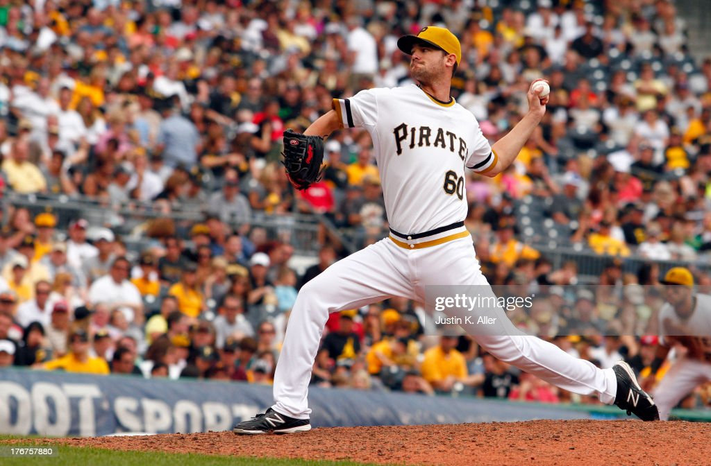 Kris Johnson #60 of the Pittsburgh Pirates pitches in the fifteenth inning during his major league debut against the Arizona Diamondbacks during the game on August 18, 2013 at PNC Park in Pittsburgh, Pennsylvania.