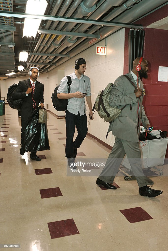 Kris Joseph #24, Brook Lopez #11 and Reggie Evans #30 of the Brooklyn Nets arrive for Game Six of the Eastern Conference Quarterfinals against the Chicago Bulls during the 2013 NBA Playoffs on May 2, 2013 at the United Center in Chicago, Illinois.