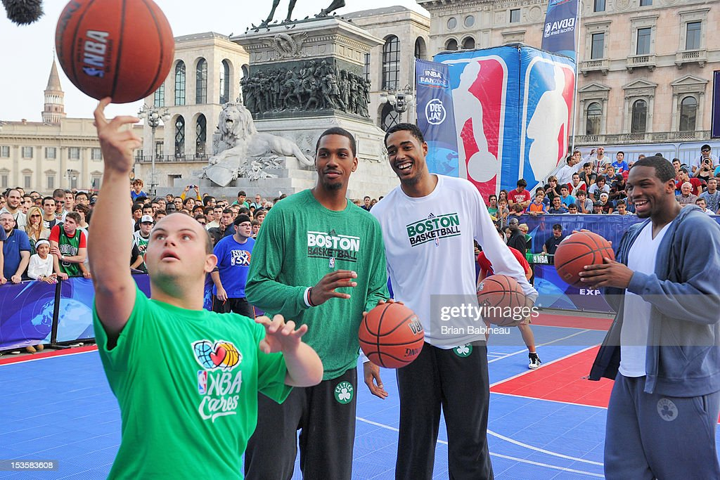 Kris Joseph #43, Fab Melo #13 and Dionte Christmas #12 of the Boston Celtics participate in activities as the Boston Celtics host an NBA Cares event with the Special Olympics on October 6, 2012 at Piazza Duomo in Milan, Italy.