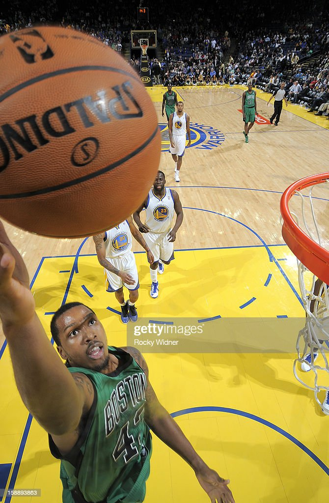 Kris Joseph of the Boston Celtics lays the ball in against the Golden State Warriors on December 29 2012 at Oracle Arena in Oakland California NOTE...