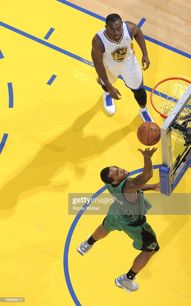 Kris Joseph of the Boston Celtics lays the ball up against Charles Jenkins of the Golden State Warriors on December 29 2012 at Oracle Arena in...
