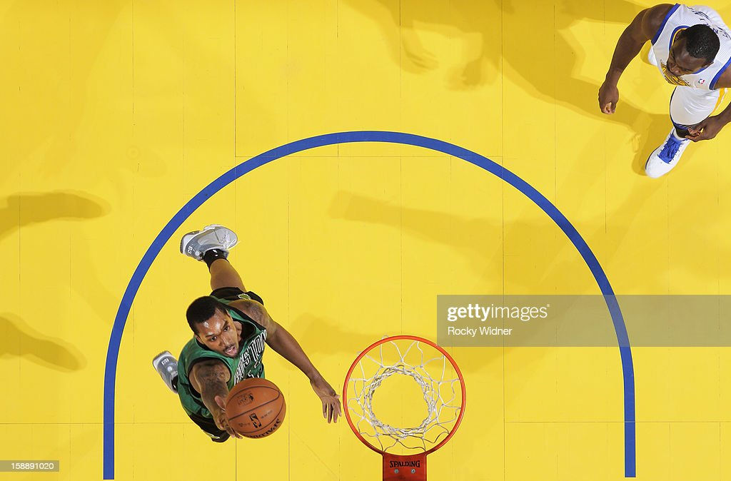 Kris Joseph of the Boston Celtics lays the ball up against the Golden State Warriors on December 29 2012 at Oracle Arena in Oakland California NOTE...