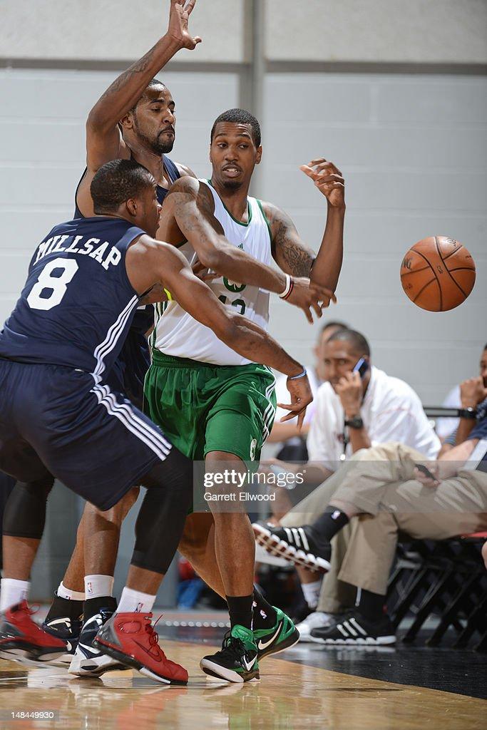 Kris Joseph of the Boston Celtics passes against Elijah Millsap of the Atlanta Hawks during NBA Summer League on July 15 2012 at the Cox Pavilion in...