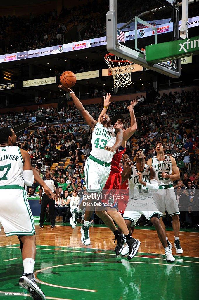Kris Joseph of the Boston Celtics tips the ball in against the Philadelphia 76ers on October 21 2012 at the TD Garden in Boston Massachusetts NOTE TO...