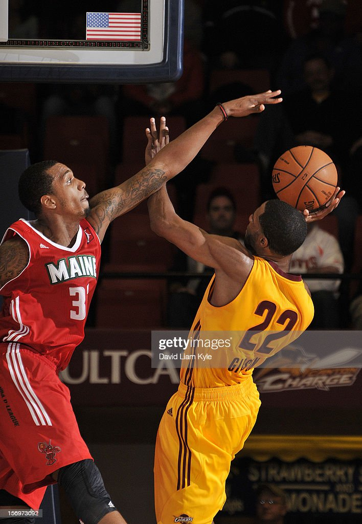Kris Joseph of the Maine Red Claws attempts to block the shot by Kyle Gibson of the Canton Charge at the Canton Memorial Civic Center on November 23...