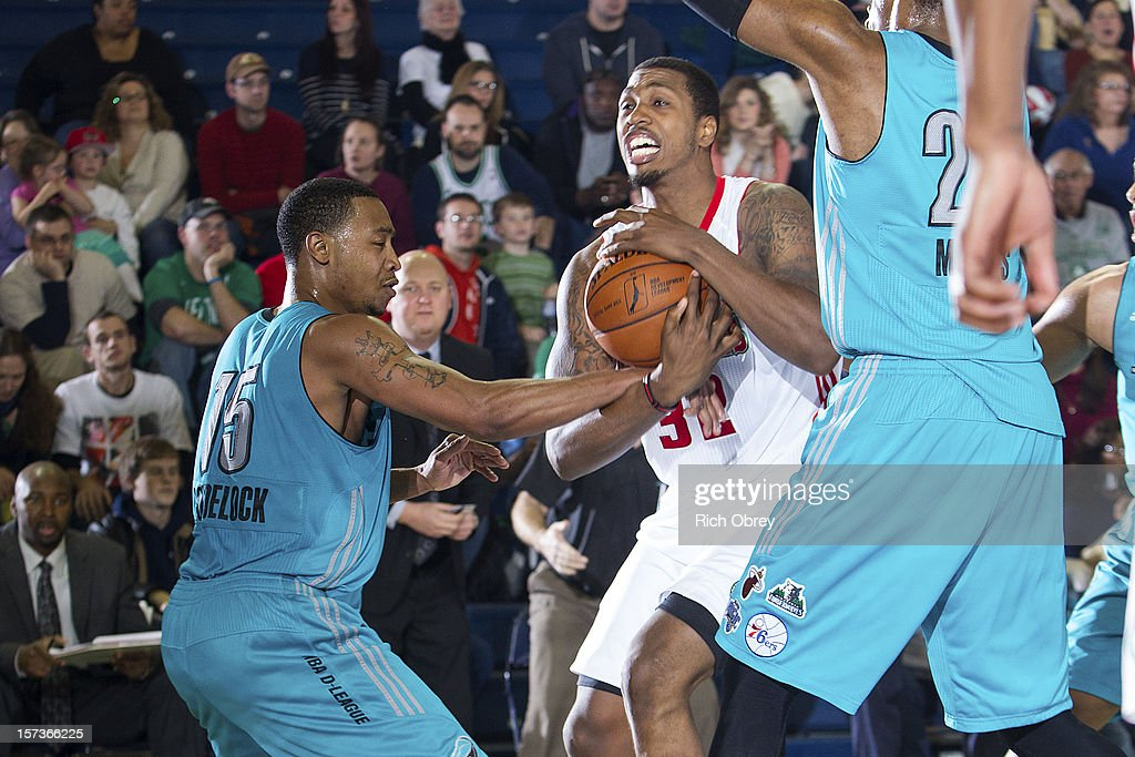 Kris Joseph of the Maine Red Claws is tied up by Andrew Goudelock of the Sioux Falls Skyforce on December 2 2012 at the Portland Expo in Portland...