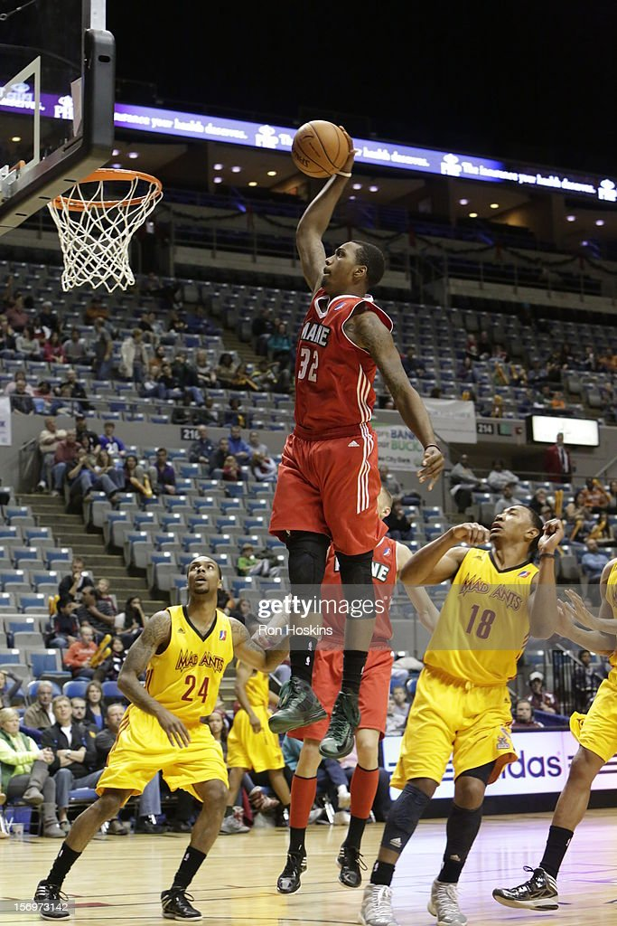 Kris Joseph of the Maine Red Claws jams over Orlando Johnson and Darryl Partin of the Fort Wayne Mad Ants at Allen County Memorial Coliseum on...