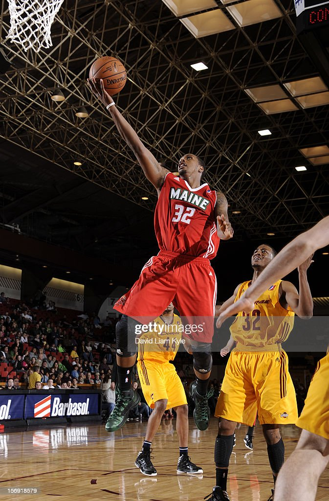 Kris Joseph of the Maine Red Claws lays in the shot against D'Aundray Brown of the Canton Charge at the Canton Memorial Civic Center on November 23...