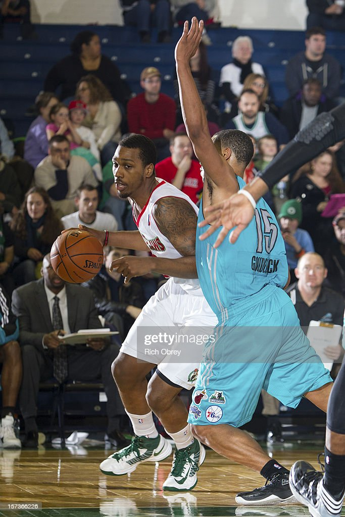 <a gi-track='captionPersonalityLinkClicked' href=/galleries/search?phrase=Kris+Joseph&family=editorial&specificpeople=5617944 ng-click='$event.stopPropagation()'>Kris Joseph</a> #32 of the Maine Red Claws plays against <a gi-track='captionPersonalityLinkClicked' href=/galleries/search?phrase=Andrew+Goudelock&family=editorial&specificpeople=7364062 ng-click='$event.stopPropagation()'>Andrew Goudelock</a> #15 of the Sioux Falls Skyforce on December 2, 2012 at the Portland Expo in Portland, Maine.