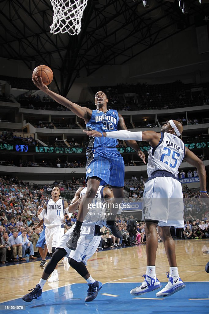 Kris Joseph of the Orlando Magic goes in for the layup against Vince Carter of the Dallas Mavericks on October 14 2013 at the American Airlines...