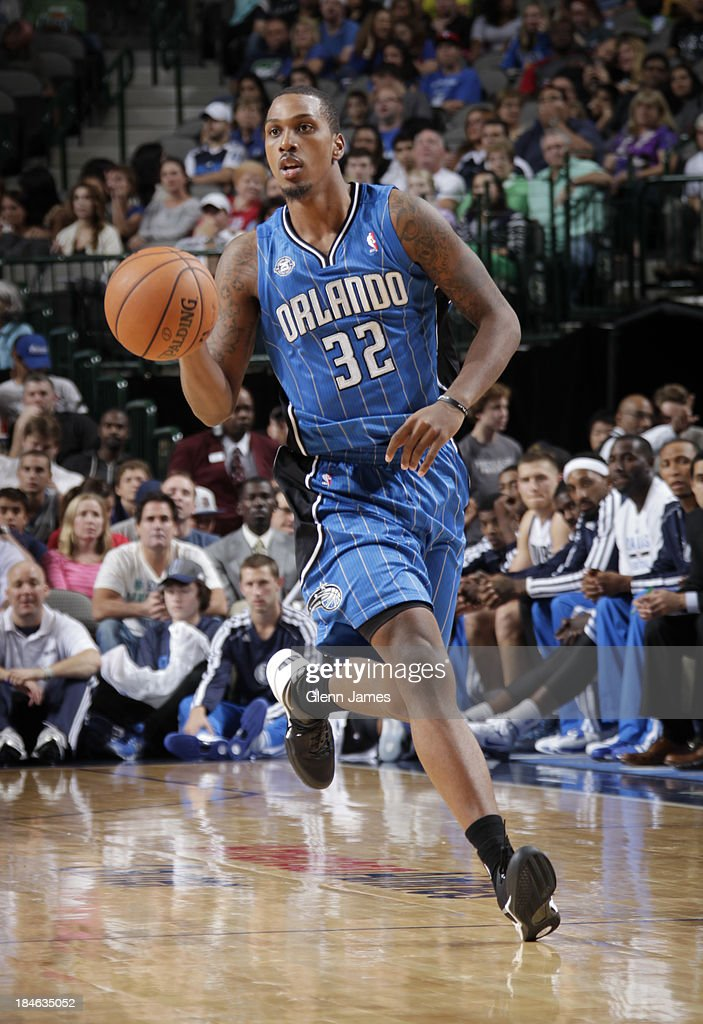 Kris Joseph of the Orlando Magic handles the ball against the Dallas Mavericks on October 14 2013 at the American Airlines Center in Dallas Texas...