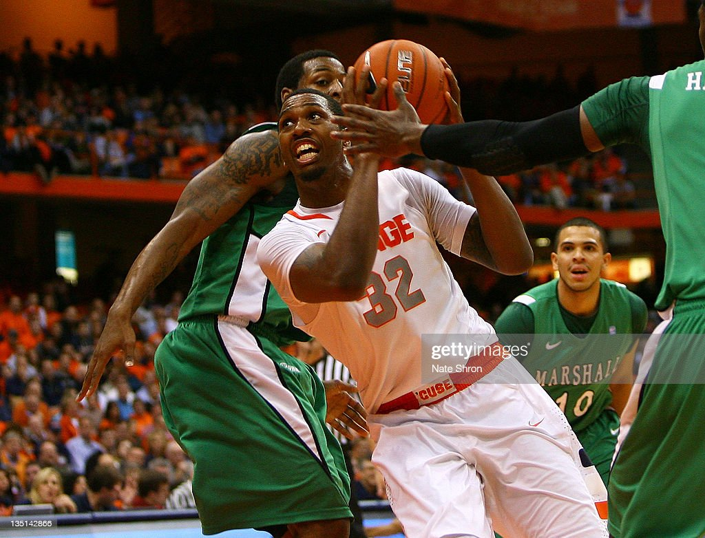 Kris Joseph of the Syracuse Orange drives to the basket against the Marshall Thundering Herd during the game at the Carrier Dome on December 6 2011...