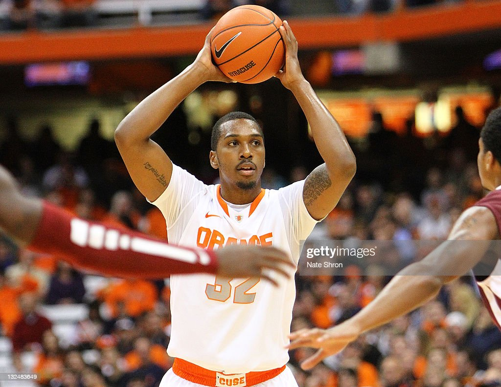 Kris Joseph of the Syracuse Orange passes the ball during the game against the Fordham University Rams at the Carrier Dome on November 12 2011 in...