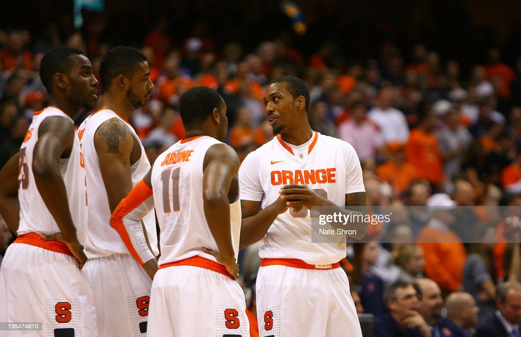 <a gi-track='captionPersonalityLinkClicked' href=/galleries/search?phrase=Kris+Joseph&family=editorial&specificpeople=5617944 ng-click='$event.stopPropagation()'>Kris Joseph</a> #32 of the Syracuse Orange talks with teammates Scoop Jardine #11, <a gi-track='captionPersonalityLinkClicked' href=/galleries/search?phrase=Fab+Melo&family=editorial&specificpeople=7366439 ng-click='$event.stopPropagation()'>Fab Melo</a> #51 and Rakeem Christmas #25 during the game against the George Washington Colonials at the Carrier Dome on December 10, 2011 in Syracuse, New York.