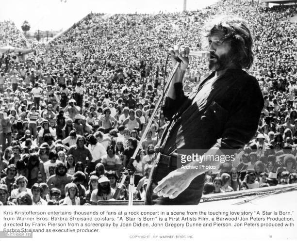 Kris Kristofferson sings on stage in a scene from the film 'A Star Is Born' 1976