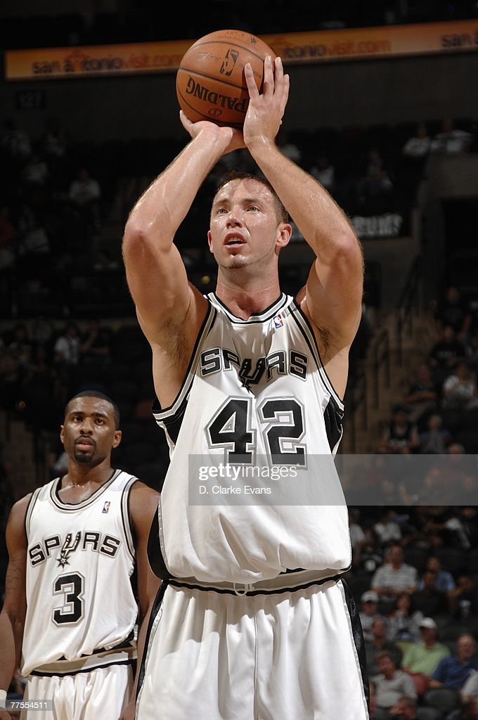 Kris Lang #42 of the San Antonio Spurs shoots a free throw during a preseason game against the Detroit Pistons at AT&T Center on October 20, 2007 in San Antonio, Texas. The Spurs won 104-80.